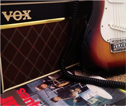 Guitar, practice amp and lessons book